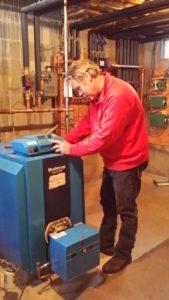 Technician Repairs Boiler